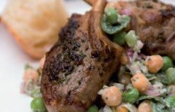 Marinated lamb cutlets with pea and minted yoghurt salad