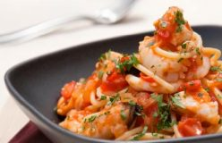 Spaghetti with seafood, fresh tomato and parsley sauce