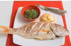 Baked whole fish with lemon, almond and herb stuffing
