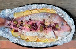 Whole baked snapper with lemon and caper berries