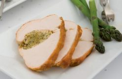 Roast turkey breast with macadamia and herb stuffing and steamed asparagus